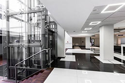 Modern hallway with glass elevator